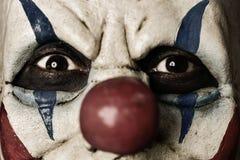 一个可怕邪恶的小丑的特写镜头 库存图片