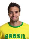 一个可爱的人的画象有巴西球衣的 免版税库存照片
