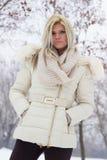 一个可爱的女孩的画象在冬天穿衣 库存照片