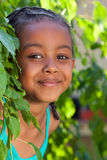 一个可爱的矮小的非裔美国人的女孩的纵向 免版税图库摄影