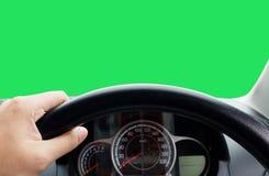 一个司机的人的手在微型货车汽车的方向盘的  免版税库存照片