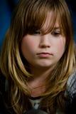 一个哀伤的女孩的画象 免版税库存照片
