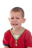 一个哭泣的男孩的特写镜头 库存图片