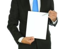 使用笔的商人指向纸 免版税库存照片