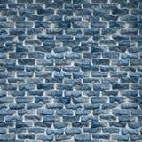 一个土气蓝色砖墙 免版税图库摄影