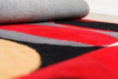 一个地毯的特写镜头与五颜六色的圈子样式的 库存图片