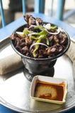 一个埃赛俄比亚的盘用肉和injara 库存图片