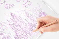 一个城市的人图画剪影有气球和云彩的在纸 图库摄影