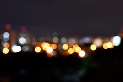 一个城市的被弄脏的光夜背景的 免版税库存图片