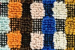 一个多色的详细的被构造的织品样式的特写镜头 库存图片