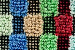 一个多色的详细的被构造的织品样式的特写镜头 免版税图库摄影