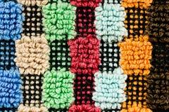 一个多色的详细的被构造的织品样式的特写镜头 图库摄影