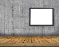 一个大空白的广告牌附加一个混凝土墙里面与木地板 库存照片
