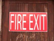 一个大红色和白色标志外面在说的篱芭太平门求爱 库存图片