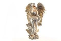 一个天使的小雕象在白色背景的 免版税库存照片