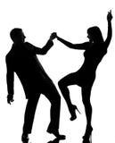 一个夫妇男人和妇女跳舞岩石 免版税库存图片