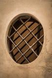 一个奇怪的矮小的卵形窗口 库存照片
