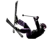 一个女子滑雪者滑雪落的剪影 免版税库存照片