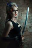 一个女孩战士的画象有剑的 库存图片