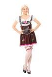 一个女孩的全长画象德国服装的 库存图片