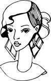 一个女孩的剪影有美丽的耳环的 免版税库存照片