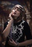 一个女孩的哥特式画象有一张美丽的面孔的 免版税库存照片