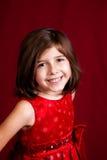 一个女孩的演播室画象红色背景的 免版税库存照片