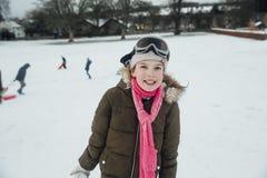 一个女孩的画象雪的 库存照片