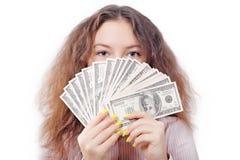 一个女孩的纵向有货币风扇的  免版税图库摄影