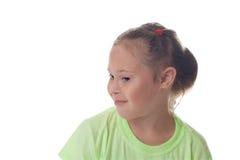 一个女孩的胸象有半被转动的金发的 免版税库存照片