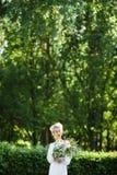 一个女孩的艺术画象白色葡萄酒礼服的 库存图片