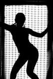 一个女孩的黑剪影白色背景的 免版税库存照片