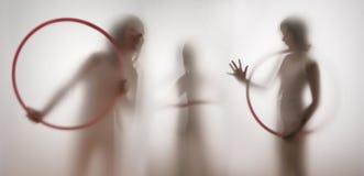 一个女孩的阴影在透明纸后的 免版税图库摄影