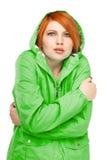 一个女孩的画象一件夹克的有一打颤的从寒冷 库存图片