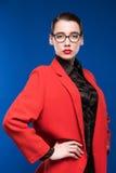 一个女孩的画象一件夹克的有红色唇膏的 库存图片