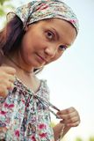 一个女孩的画象减速火箭的礼服的 图库摄影