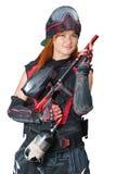 一个女孩的画象制服的有迷彩漆弹运动的开枪 库存照片