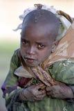 一个女孩的画象在工作,水拿来 库存图片