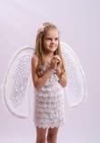 一个女孩的画象天使服装的 图库摄影