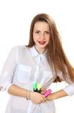 一个女孩的画象有红色标志的在手中 库存照片