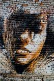 一个女孩的画象油漆的在墙壁上 库存图片