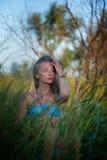 一个女孩的画象芦苇的 库存照片
