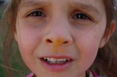 一个女孩滑稽的表示 免版税库存照片