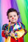 一个好孩子佩带的小丑衣裳。 免版税库存照片