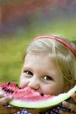 一个孩子用西瓜 库存图片