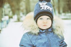 一个孩子的画象冬天衣裳的 图库摄影