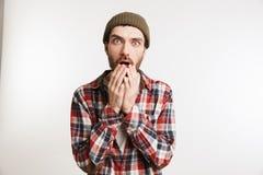 一个害怕的有胡子的人的画象格子花呢上衣的 免版税库存图片
