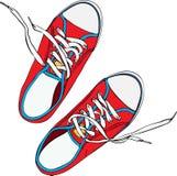 一个对红色践踏了有鞋带的老鞋子解开了白色 免版税图库摄影