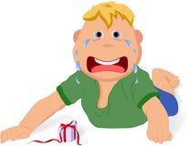 一个小男孩不满意对他的礼物 免版税图库摄影