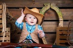 一个小男孩的画象牛仔装饰的 免版税库存图片